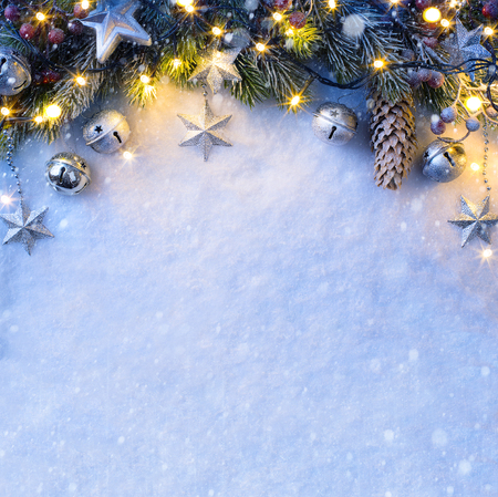 Foto de Christmas background with a silver ornament, christmas stars, berries and fir in snow - Imagen libre de derechos
