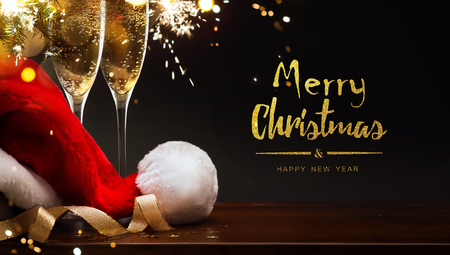 Foto de  merry Christmas and happy New year; champagne and Santa hat - Imagen libre de derechos