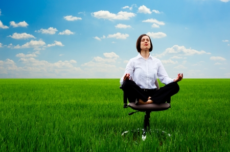 Photo for businesswoman practicing yoga at the meadow at sunny day - Royalty Free Image