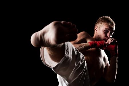 studio portrait of fighter over black background