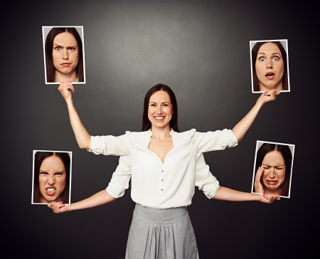 smiley woman with four hands holding pictures with different emotional faces