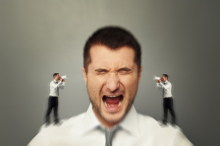 Photo for emotional man listening his inner voice over grey background - Royalty Free Image