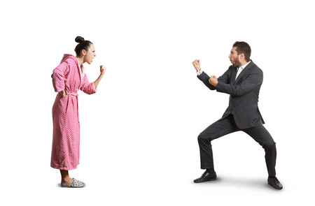 Foto de fight between angry wife and emotional husband. isolated on white background - Imagen libre de derechos