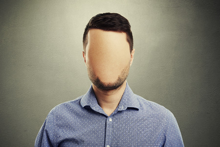 Photo pour anonymous man with blank face against dark background - image libre de droit