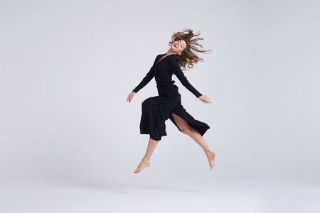 Photo pour Full-length shot of young attractive woman hovering in the air - image libre de droit