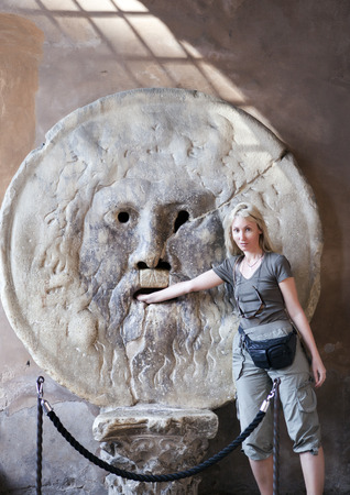 Photo for Italy. Rome. Woman tourist puts hand to mouth of truth - Royalty Free Image