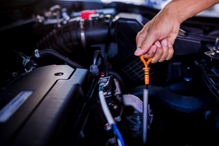 Foto de Check the oil level in car engine. Mechanic checking car engine or vehicle. Check and maintenance car with yourself. Service and maintenance vehicle. - Imagen libre de derechos