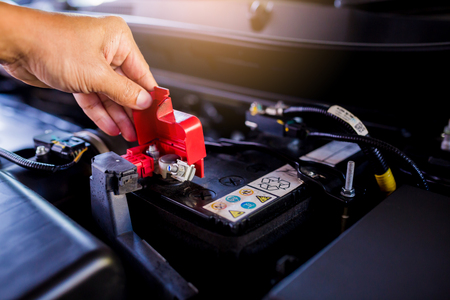 Foto de Check and maintenance the battery in car with yourself. Service and maintenance car or vehicle. - Imagen libre de derechos