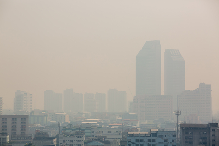 Foto de Office building under smog in Bangkok. Smog is a kind of air pollution. Bangkok City in the air pollution. - Imagen libre de derechos