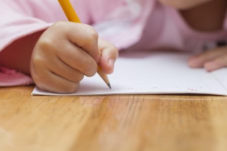 Photo for Little girl doing her homework - Royalty Free Image