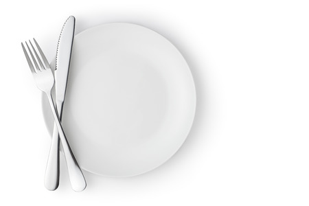 Photo for Fork and knife on a empty plate, Isolated on white. - Royalty Free Image