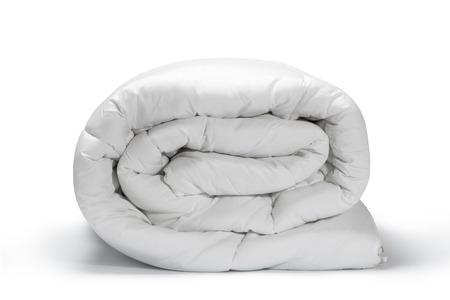 Photo pour Warm and confortable folded white quilt on white background - image libre de droit