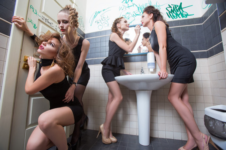 Foto de drunk girl in toilet bars. beautiful women in evening dresses in alcoholic intoxication - Imagen libre de derechos