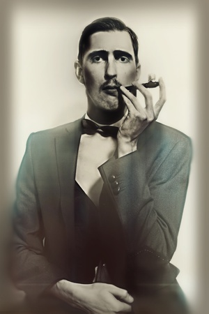 Photo pour retro portrait of an adult man smoking a pipe closeup - image libre de droit