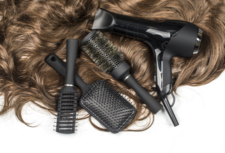 Photo for hairdressers tools on a background of the brown hair - Royalty Free Image