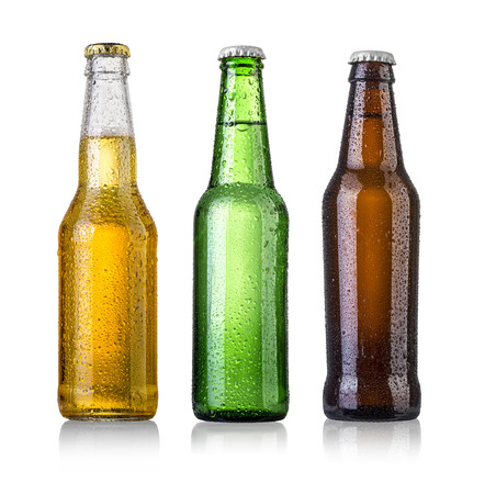 Foto de set of Beer bottles with water drops on white background.Five separate photos merged together. - Imagen libre de derechos
