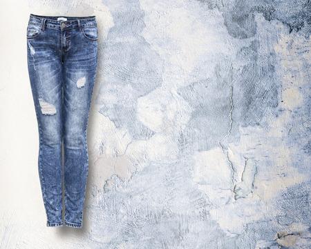 Foto de woman jeans in light light grunje background with copy space - Imagen libre de derechos