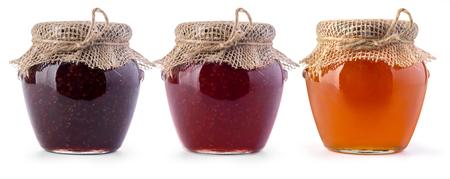 Foto de Three jar of jam and honey on white background - Imagen libre de derechos