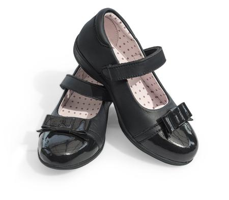 Photo pour Black shine leather girl shoes isolated on white - image libre de droit