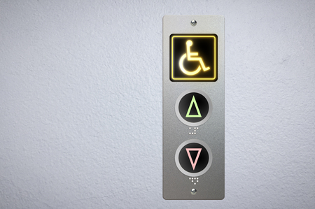 Photo pour Elevator buttons panel with an amber glowing light button for handicap and Braille code for the visually impaired. - image libre de droit