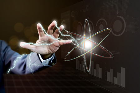 Foto de Hand and arm of power businessman with lightning thunder in concept of magical power of business information technology - Imagen libre de derechos