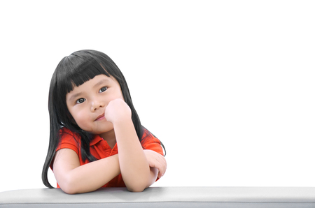 Photo pour Asian children cute or kid girl think and happy fun or smile with wear red shirt on sofa at preschool or nursery and child hospital on white isolated with space included clipping path - image libre de droit