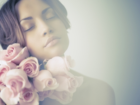 Photo for Art photo of charming young lady with roses - Royalty Free Image