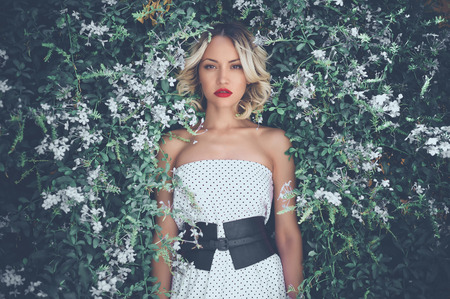 Photo for Portrait of beautiful romantic lady in the flowered garden - Royalty Free Image