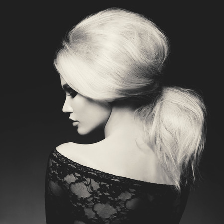 Photo for Black and white fashion studio portrait of beautiful blonde woman with elegant hairstyle on black background - Royalty Free Image