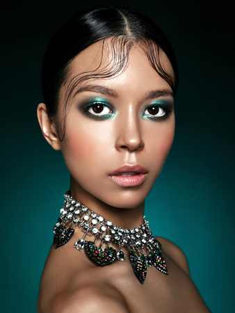 Photo pour Fashion studio portrait of beautiful asian woman with diamond necklace. Fashion and Beauty. Perfect makeup - image libre de droit