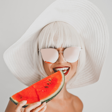 Photo pour Outdoor fashion photo of young beautiful lady in hat and sunglasses with watermelon. Summer Beach travel. Summer vibes - image libre de droit
