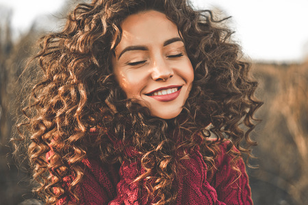 Photo for Outdoor atmospheric lifestyle photo of young beautiful lady. Brown hair and eyes. Warm fall. Autumn vibes. Softness, warmth and comfort - Royalty Free Image