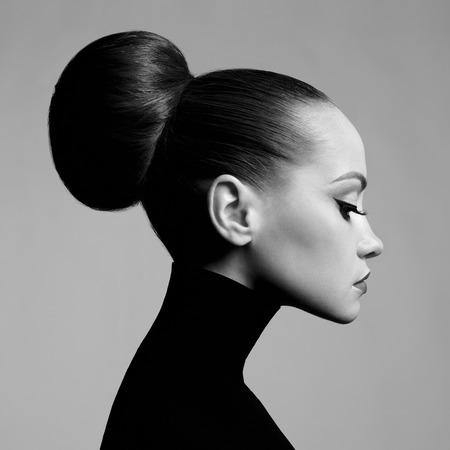 Photo pour Black and white fashion art studio portrait of beautiful elegant woman in black turtleneck.  Hair is collected in high beam.  Elegant ballet style - image libre de droit