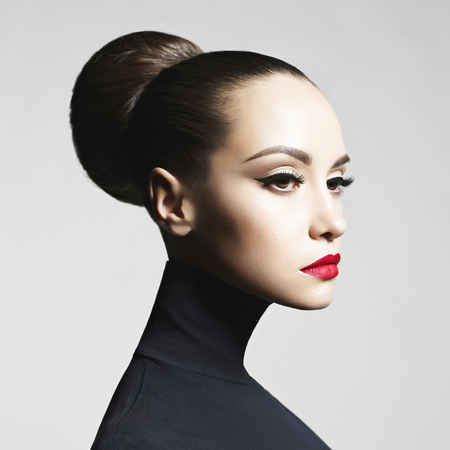 Photo pour Fashion art studio portrait of beautiful elegant woman in black turtleneck.  Hair is collected in high beam.  Elegant ballet style - image libre de droit