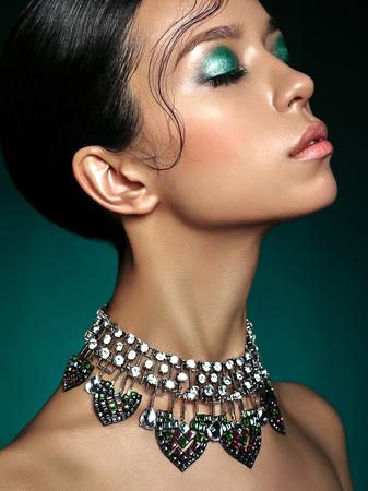 Foto de Fashion studio portrait of beautiful asian woman with diamond necklace. Fashion and Beauty. Perfect makeup - Imagen libre de derechos