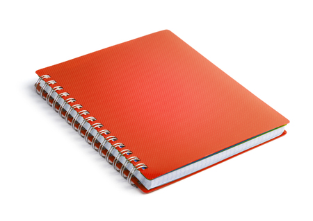 Foto de Red closed paper notepad isolated on white background - Imagen libre de derechos