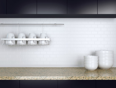Ceramic kitchenware on the marble worktop. Black and white kitchen design.