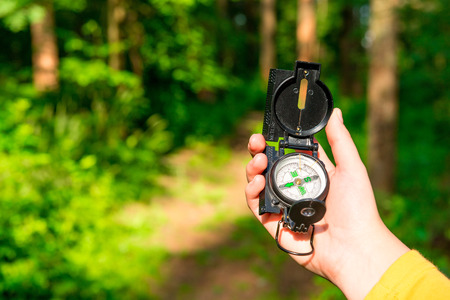 Photo for compass in a female hand lost in the woods - Royalty Free Image
