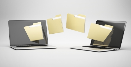 Foto de transferring between two laptops  isolated on a white background - Imagen libre de derechos