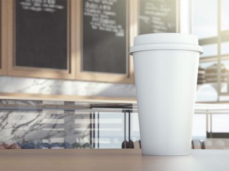 Photo pour Cup on cafe table - image libre de droit