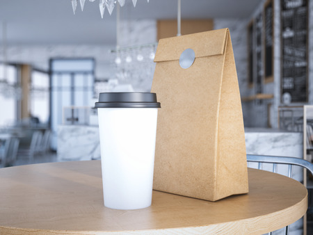 Foto de Coffe cup and paper bag on table. 3d rendering - Imagen libre de derechos
