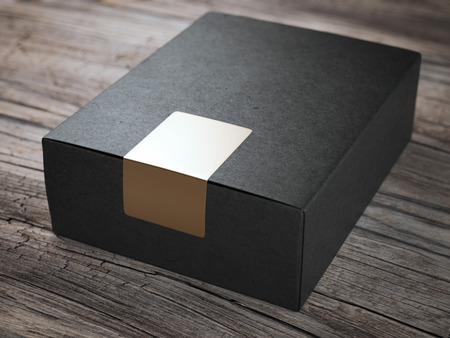 Foto de Black box with golden sticker - Imagen libre de derechos