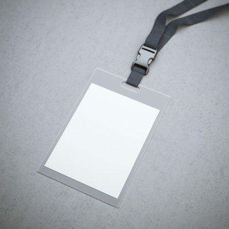 Foto de Blank badge with neckband on the concrete floor - Imagen libre de derechos
