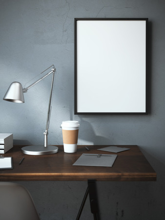 Foto de Workplace with cup and blank frame on the wall. 3d rendering - Imagen libre de derechos