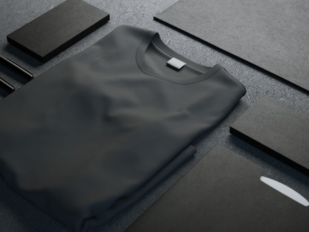 Foto de Dark mockup with blank t-shirt and business cards - Imagen libre de derechos