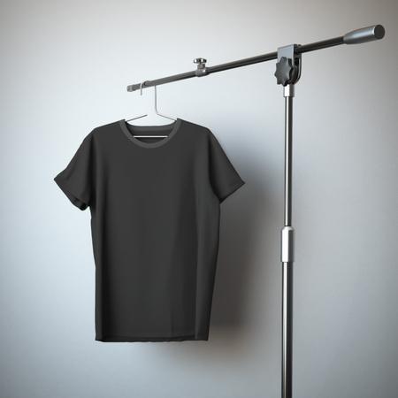Foto de Black t-shirt hanging on the tripod stand - Imagen libre de derechos