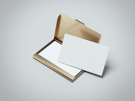 Foto de White business cards with golden holder. 3d rendering - Imagen libre de derechos