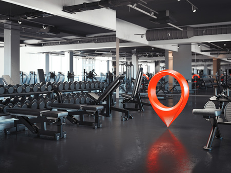 Foto de Gym with white walls and dark floor with red geotag, 3d rendering - Imagen libre de derechos