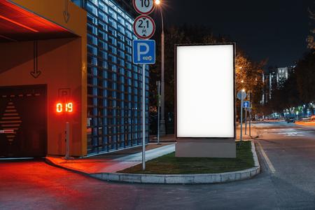 Foto de Blank white outdoor banner stand at night time in the city, 3d rendering. - Imagen libre de derechos