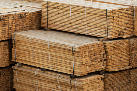 Photo for lumber in a large warehouse. Wooden boards in the stack - Royalty Free Image